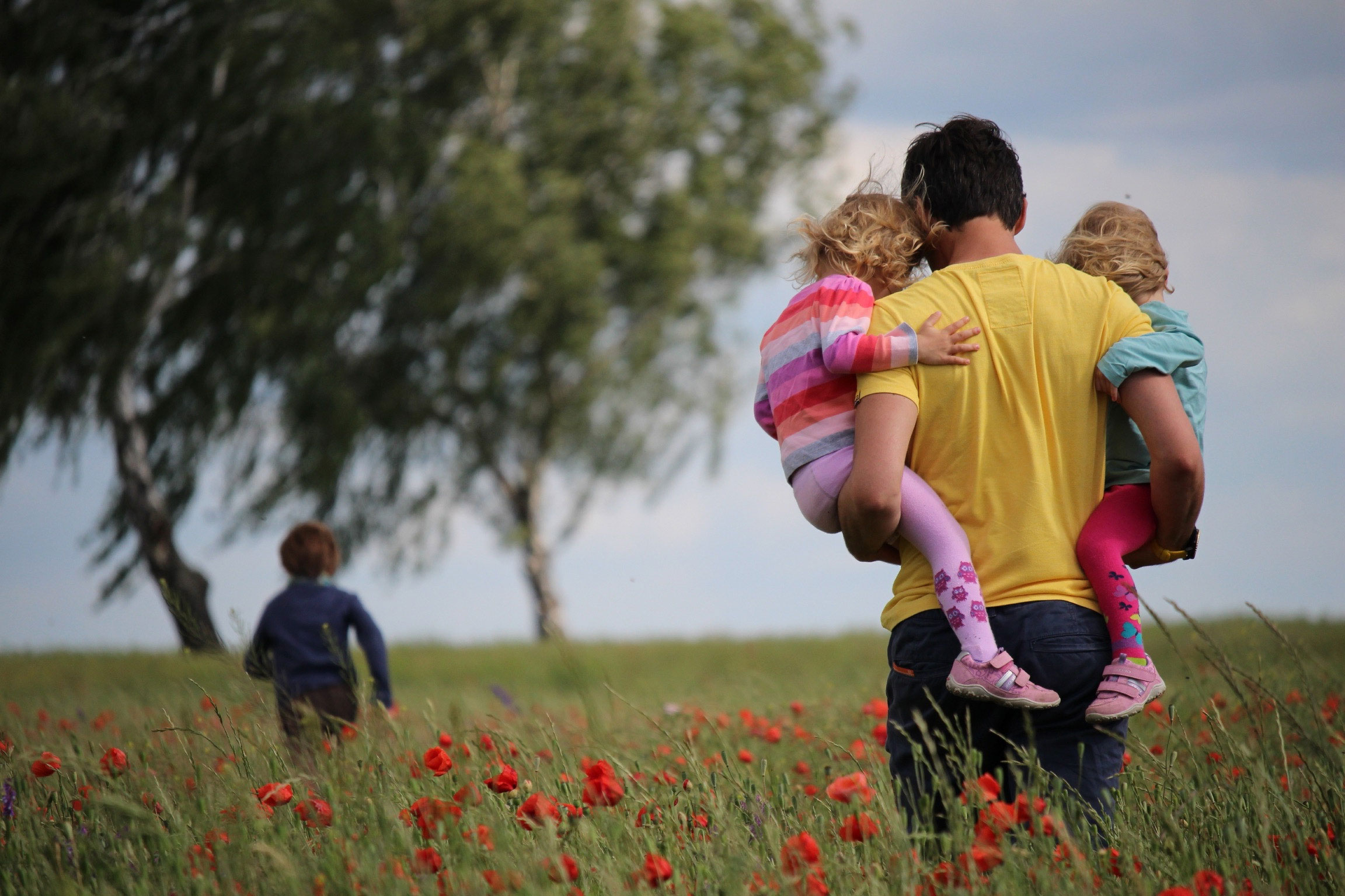 Father with children in field